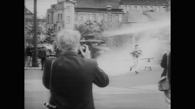 east german military turn armored water trucks on western reporters - 1961 stock-videos und b-roll-filmmaterial