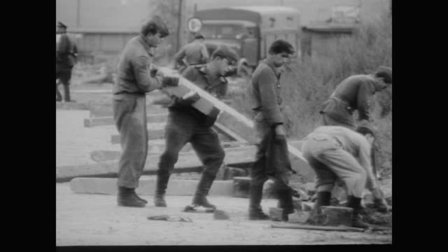 east german police and military erect barrier along border of east and west berlin - 1961 stock-videos und b-roll-filmmaterial