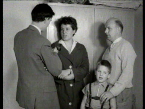 east german refugees queue / interview with woman standing with her husband and young son / they taught at teacher training school in the east and... - 西ドイツ点の映像素材/bロール