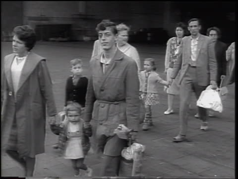 east german refugees walking past camera / beginning of berlin wall / west germany - 1961 stock-videos und b-roll-filmmaterial