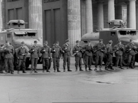 east german soldiers line up next to their mobile water cannons at the brandenburg gate 15/08/61 - 1961 stock videos & royalty-free footage