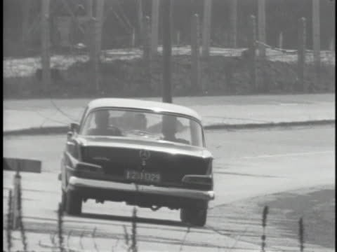 east german soldiers stop a car as it passes over the border - 1950 1959 stock videos & royalty-free footage