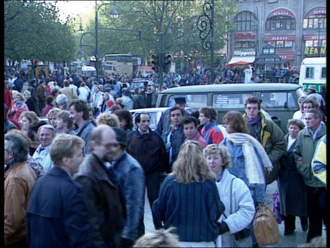 east germans visit west following fall of berlin wall east germany east berlin ext crowds of east germans in queue for food west germany west berlin... - banane stock-videos und b-roll-filmmaterial