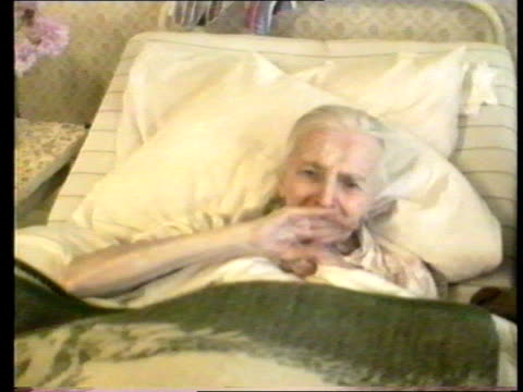 effects of exodus east germany leipzig side nurse attends to bedclothes as old lady in hospital bed tms ditto ms side line of highsided beds with old... - east germany stock videos and b-roll footage