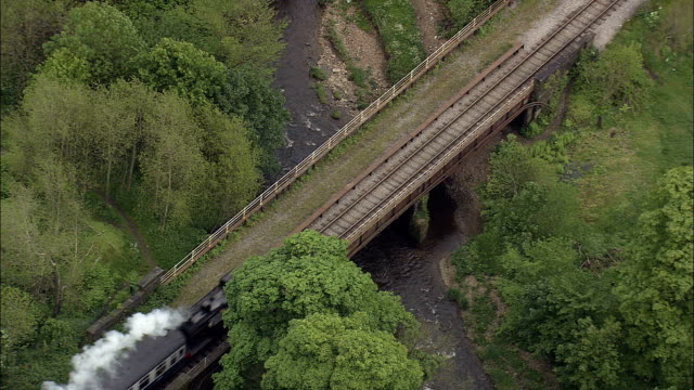 east lancashire steam railway  - aerial view - england,  lancashire,  rossendale district helicopter filming,  aerial video,  cineflex,  establishing shot,  united kingdom - locomotive stock videos and b-roll footage