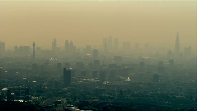 emission reducing measures not meeting targets LIB AIR VIEW AERIAL over London in thick fog / smog