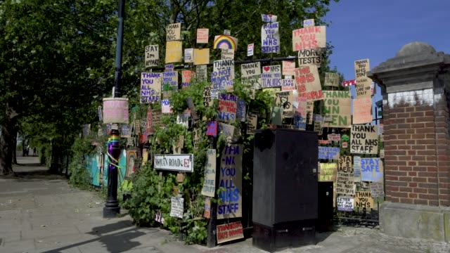 east london artist peter liversidge creates signs to support key workers during the coronavirus on may 27 2020 in london england the british... - land vehicle stock videos & royalty-free footage