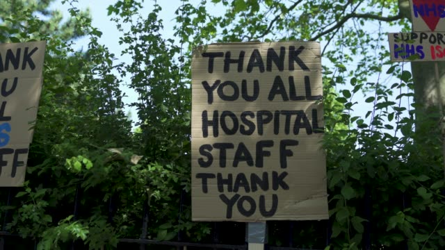 east london artist peter liversidge creates signs to support key workers during the coronavirus on may 27 2020 in london england the british... - key stock videos & royalty-free footage