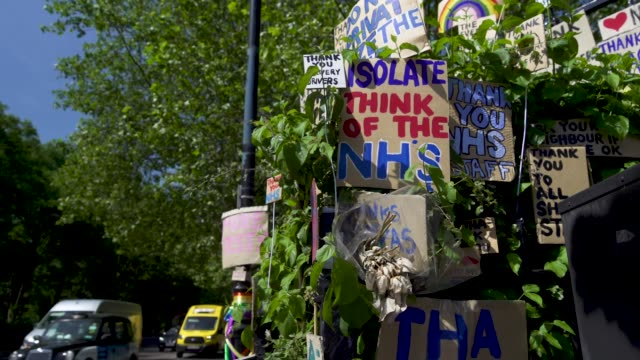 capsule east london artist peter liversidge creates signs to support key workers during the coronavirus on may 27 2020 in london england the british... - land vehicle stock videos & royalty-free footage