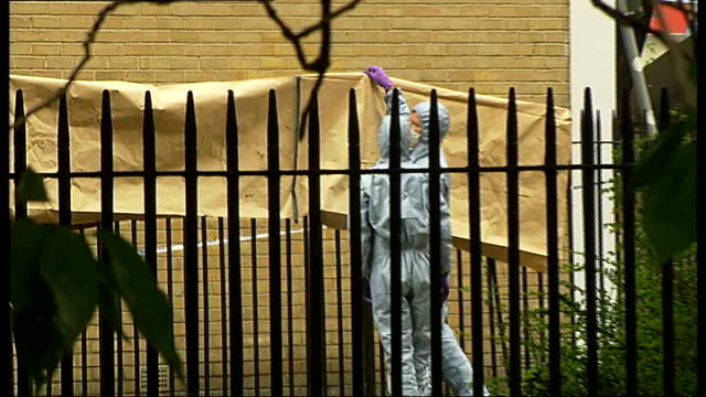 hackney: st thomas's place: ext forensic officers sealing off scene where 14-year-old boy was fatally stabbed police 'a' marker on ground forensic... - b rolle stock-videos und b-roll-filmmaterial