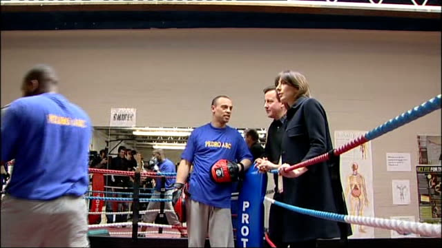 david cameron mp and his wife, samantha cameron, watching boxers training in ring during visit to youth club - youth club stock videos & royalty-free footage