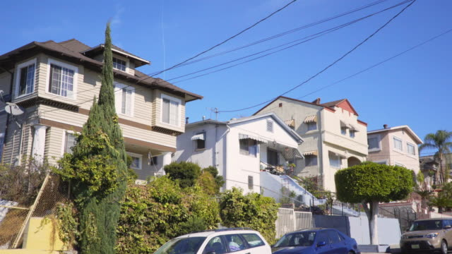 east los angeles multi family homes - day - tilt stock videos & royalty-free footage