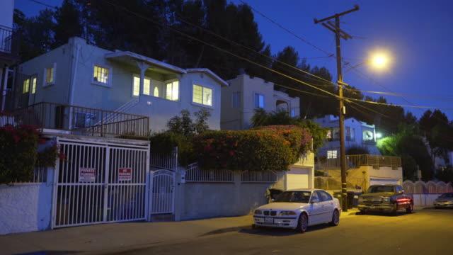 vídeos de stock e filmes b-roll de east los angeles neighborhoods - night - portão