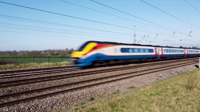 east midlands meridian class 222 train travelling towards london. - rail transportation stock videos & royalty-free footage