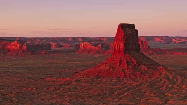 aerial east mitten butte in monument valley at sunrise - mitten stock videos and b-roll footage