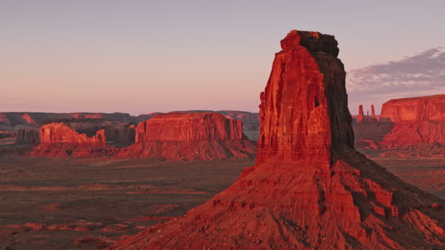 aerial east mitten butte, monument valley, usa, in the early morning sun - mitten stock videos and b-roll footage