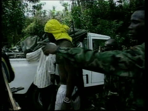 east of freetown rogberi junction sierra leone army soldiers pulling white land rover with un stencilled on side out of ditch sla soldiers walking... - sierra leone stock videos & royalty-free footage
