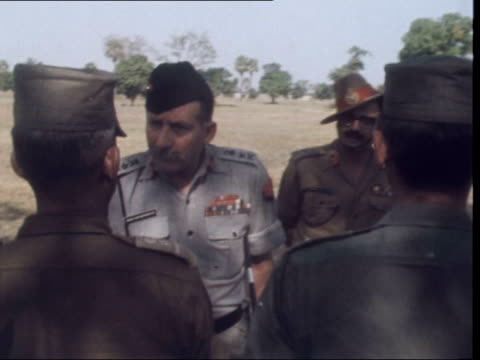 indian army moves pows from dacca east pakistan [bangladesh] dacca ext richard lindley sof r prisoners guard gvs field marshal sam manekshaw along... - indian army stock videos & royalty-free footage
