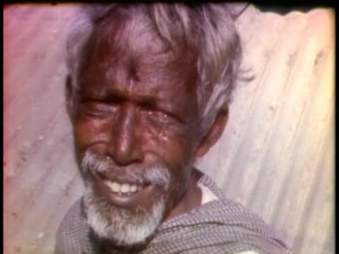 east pakistani man weeps in the aftermath of atrocities committed in his village by pakistani troops. - (war or terrorism or election or government or illness or news event or speech or politics or politician or conflict or military or extreme weather or business or economy) and not usa stock videos & royalty-free footage