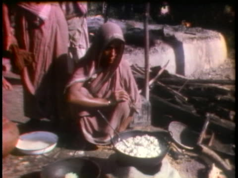 east pakistani refugee women cook outdoors; they are displaced refugees. - healthcare and medicine or illness or food and drink or fitness or exercise or wellbeing stock videos & royalty-free footage