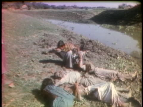 east pakistanis bury their dead near a riverbank; their village was the subject of violence by pakistani troops. - (war or terrorism or election or government or illness or news event or speech or politics or politician or conflict or military or extreme weather or business or economy) and not usa stock videos & royalty-free footage