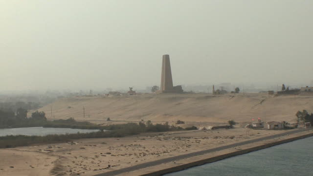 ws ha east side of suez canal with defense monument in background, ismailia, egypt - suez canal stock videos & royalty-free footage