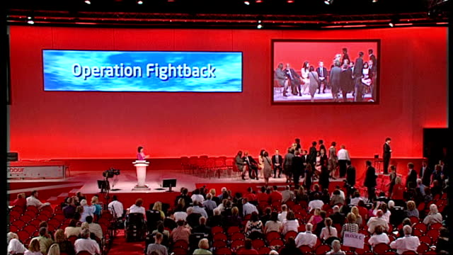 brighton: int young new labour candidates arriving on stage at conference wide shot of new labour candidates arriving on stage with 'operation... - applauding stock videos & royalty-free footage