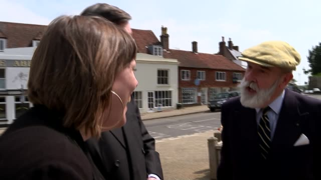 east sussex hastings ext jess phillips mp playing whackamole at amusement arcade as jacob reesmogg mp looks on union jack flag flying with sun behind... - tattoo stock videos and b-roll footage