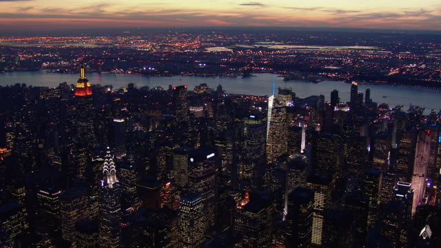 East view over Midtown Manhattan as night falls in New York City.