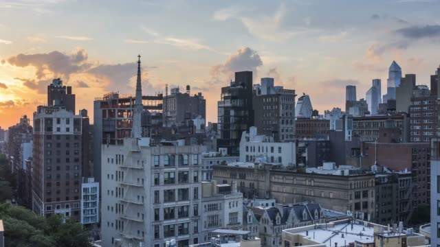 east village sunset time lapse - new york - steeple stock videos & royalty-free footage