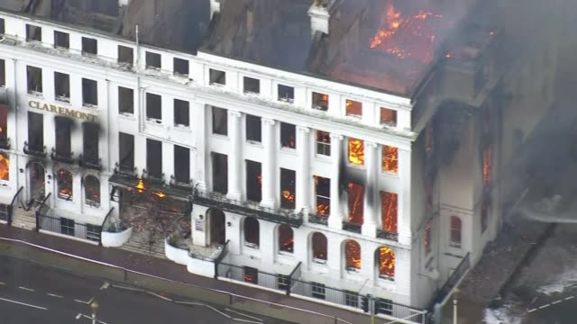 eastbourne hotel destroyed by fire england east sussex eastbourne claremont hotel on fire and firefighters hosing down flames as smoke billows from... - east sussex stock videos & royalty-free footage