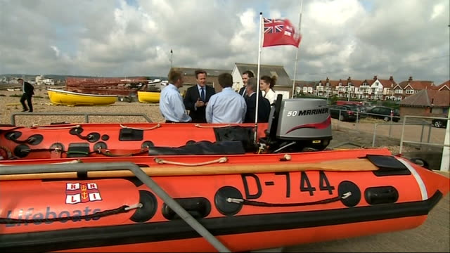 david cameron visit england east sussex eastbourne ext david cameron mp and george osborne mp along to meet eastbourne lifeboat crew members /... - arcade fire stock videos & royalty-free footage