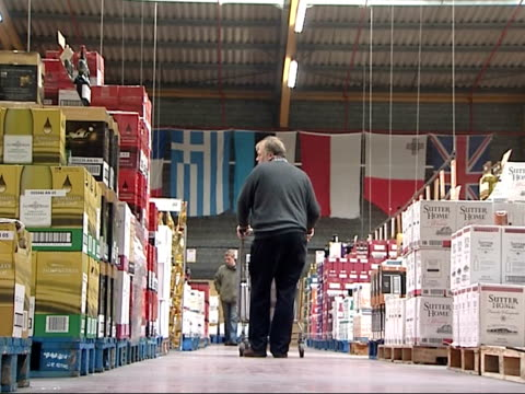 eastenders wine hypermarket; france: calais int shoppers in eastenders wine hypermarket / boxes of wine on display / shoppers browsing / wines - eastenders stock-videos und b-roll-filmmaterial