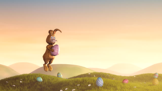 Easter bunny jumping with a decorated egg