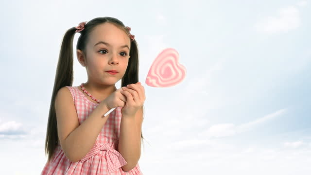 easter candy girl - lollipop stock videos and b-roll footage