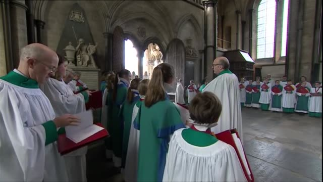 easter sunday service at salisbury cathedral; england: wiltshire: salisbury: salisbury cathedral: int candles burning / stained glass window / gold... - choir stock videos & royalty-free footage