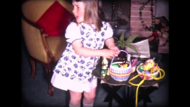 1965 easter egg hunt with family - カーテン レース点の映像素材/bロール