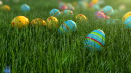 Easter eggs on the grass. Easter eggs slide down the slope covered with green cereal. Sunny positive climate.