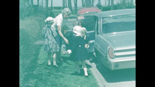 1954 Easter Home Movie - three young girls with Easter baskets