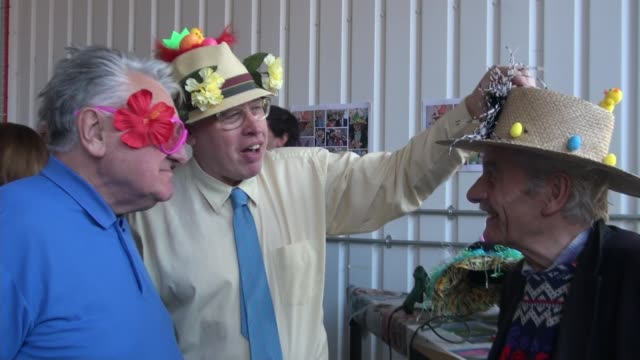 easter lunch held for lonely elderly people in hackney uk england elderly people and volunteers wearing and making easter bonnets with flowers guests... - roast dinner stock videos & royalty-free footage