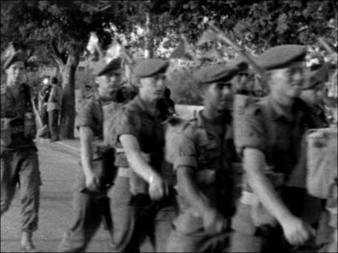 jerusalem troops marching towards / soldiers marching / bv soldiers away from camera / cs women in uniform marching towards singing / bv away from... - happy easter stock-videos und b-roll-filmmaterial
