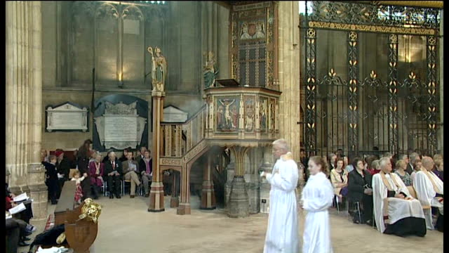 easter service at canterbury cathedral; int dr rowan williams to pulpit at hymn sung sot - canterbury cathedral stock videos & royalty-free footage