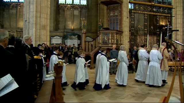 Archbishop of Canterbury gives Easter sermon EXT Welby and other clergy along and entering cathedral INT **Music heard SOT** Clergy including Welby...