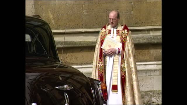 royal family arrive at church; england: berkshire: windsor: st george's chapel: ext lms david connor chatting with policeman, lms vicar speaking with... - sophie rhys jones, countess of wessex stock videos & royalty-free footage