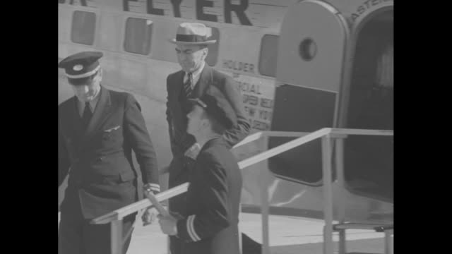 """eastern airlines """"florida flyer"""" airplane coming in for a landing, touching down, and coming to a stop / eddie rickenbacker, world war i ace pilot... - landing touching down stock videos & royalty-free footage"""
