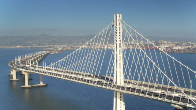 eastern bay bridge traffic - drone shot - san francisco oakland bay bridge stock videos and b-roll footage