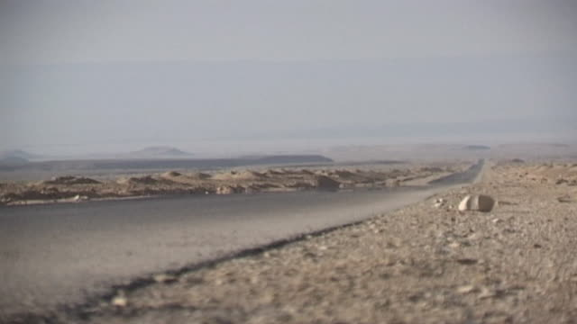 eastern desert low angle view of a lonely road stretching into the distance - solitude stock videos & royalty-free footage