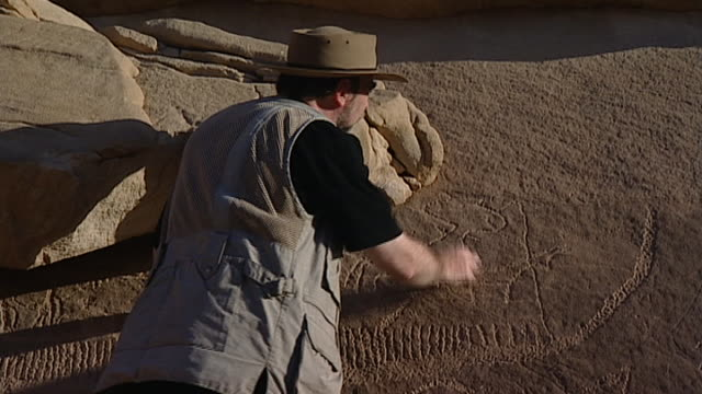 eastern desert rock art. archaeological survey. - archaeologist stock videos & royalty-free footage