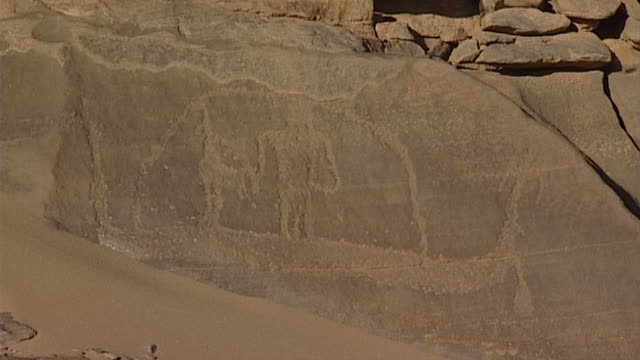 eastern desert rock art. boat petroglyph. - extreme terrain stock videos & royalty-free footage