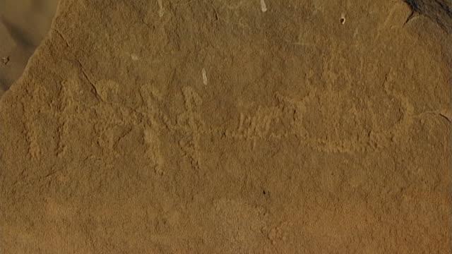 eastern desert rock art. dragging boat petroglyph. - dragging stock videos & royalty-free footage